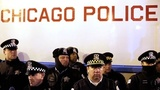 Chicago cop sues estate of teen he...