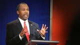 Carson staying in race, sees South...