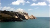 Cliff collapses after quake hits New...