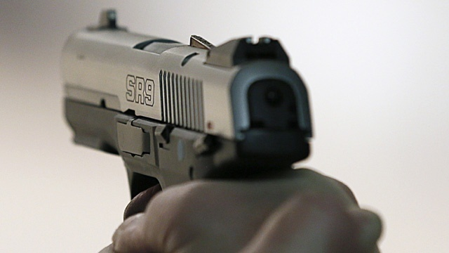 Man accidentally shoots self, wife during church lunch