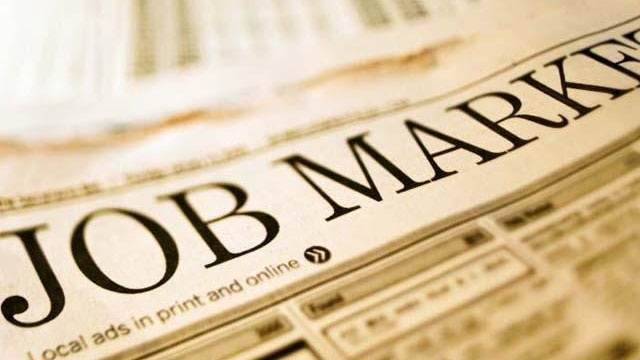 Applications for US jobless aid rise but remain at low level