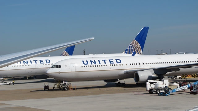 Police violently drag man from United plane after airline reportedly overbooked flight