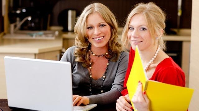 Young women using laptop computer for small business_2473499858512768