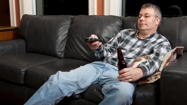 Man on couch watching TV, couch potato_1663277605117276