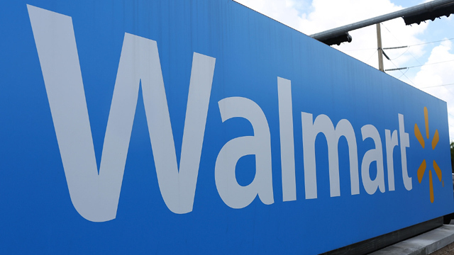 Man stands under broken Walmart sign hoping to be hit