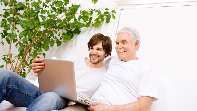 father and son using laptop computer74628368