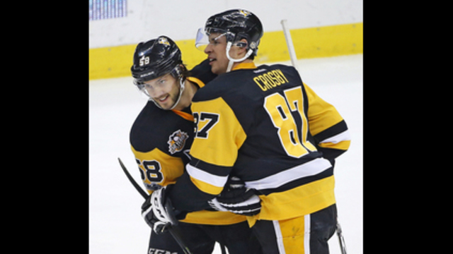 Crosby gets 1,000th point, adds OT goal