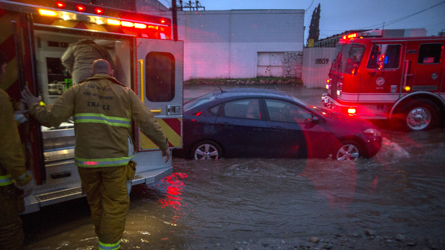 California flood firefighers and ambulance.jpg53173904