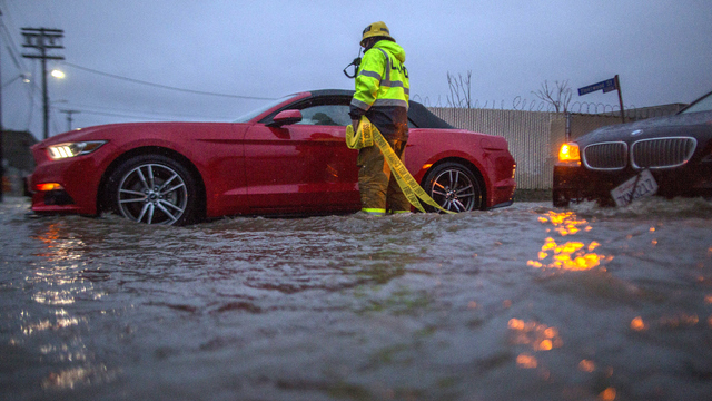California flood firefighter checks car.jpg21605690