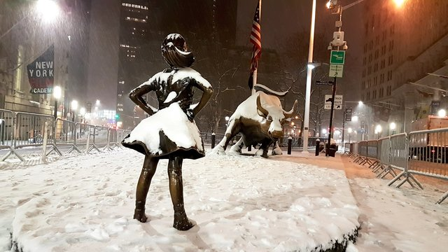 Fearless girl covered in snow11170139