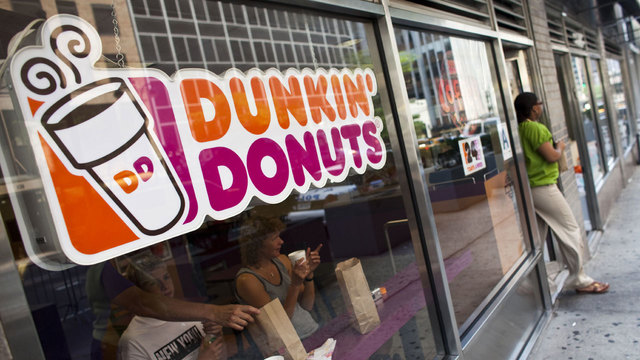 Dunkin' Donuts sign in store window60154503