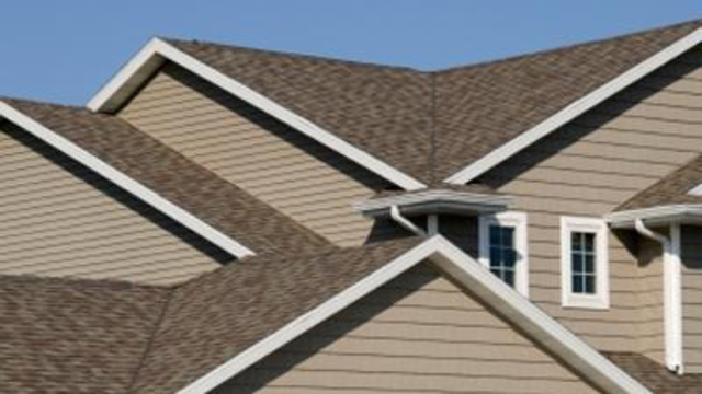 How are roofing costs estimated?