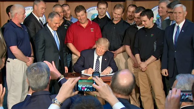 Trump signs climate change_1490729782811.jpg49281455