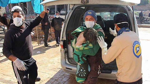 Dozens dead after suspected gas attack in rebel-held Syrian town