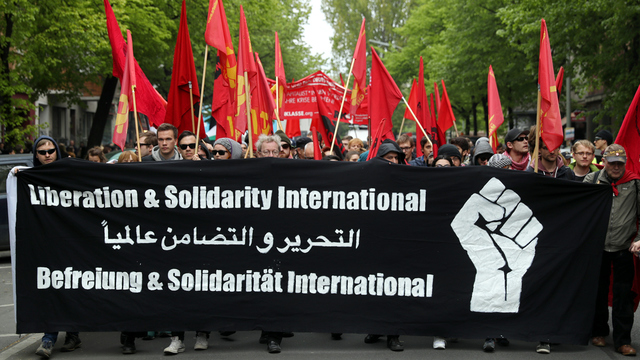 May Day Berlin Protest Sign and Flags.jpg49459537