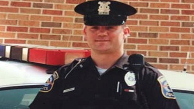 A white officer claims he was racially taunted for his African heritage