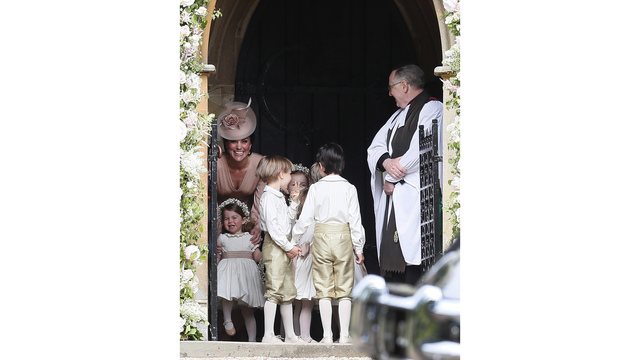 Cathering Kate Duchess of Cambridge, with Princess Charlotte at Pippa wedding93500910