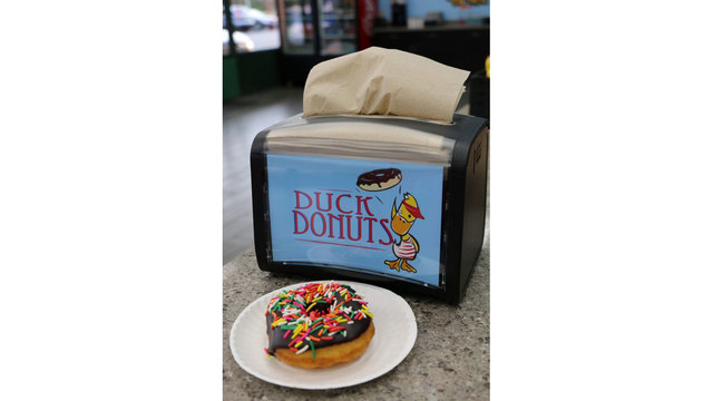Duck Donuts chocolate donut with sprinkles27978214