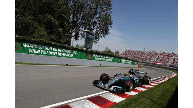 Lewis Hamilton wins Canadian GP to lower championship deficit""