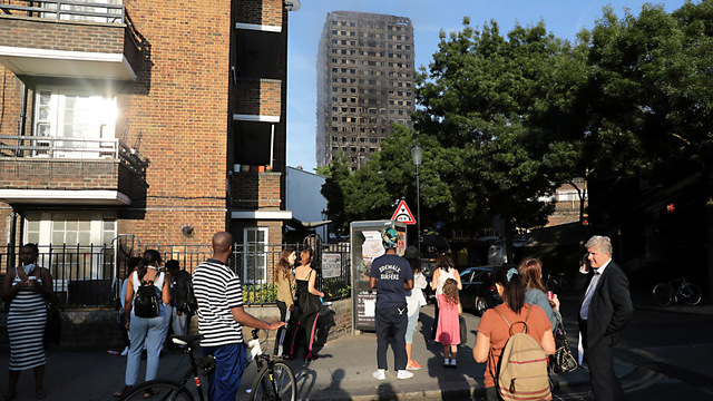 PM May orders public inquiry as Grenfell death toll rises to 17