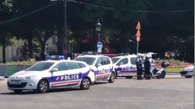 Car rams police van on Champs-Elysees, armed suspect may be dead, police say