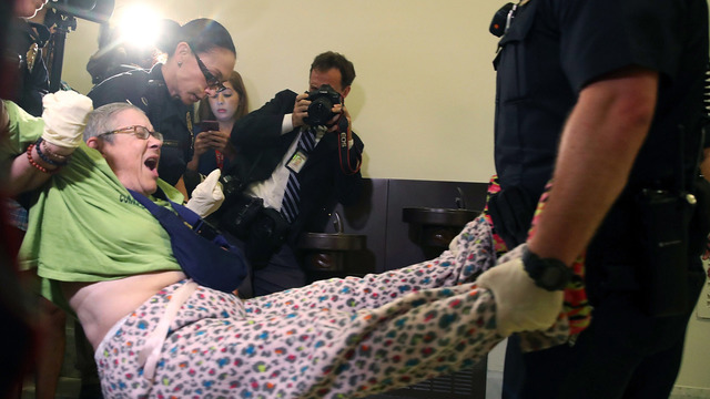 disabled protesters outside mcconnell's office44053702