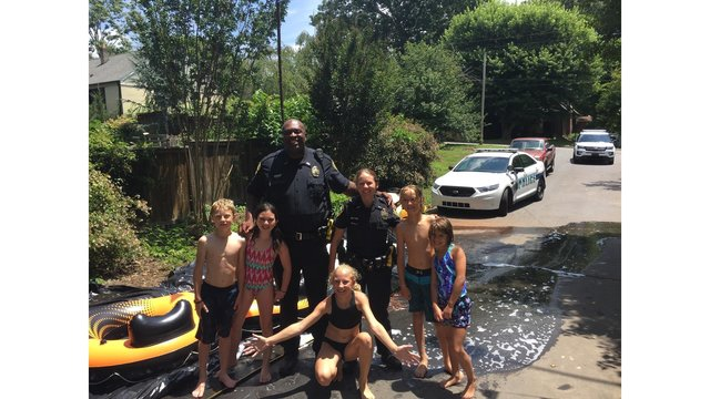 Police in NC respond to complaint about slip-and-slide, end up going on it