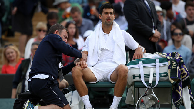 Federer makes Wimbledon semifinals for 12th time; Djokovic retires with injury