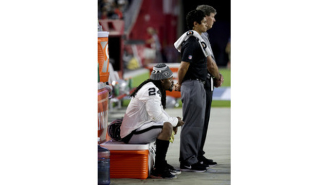 Raiders' Lynch sits for national anthem