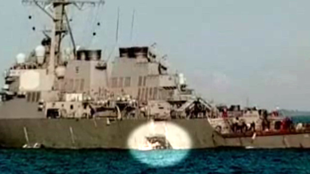 Remains of missing found in USA  destroyer damaged off Singapore