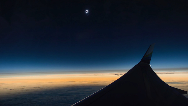 Watching solar eclipse Alaska Airlines flight.jpg94989491