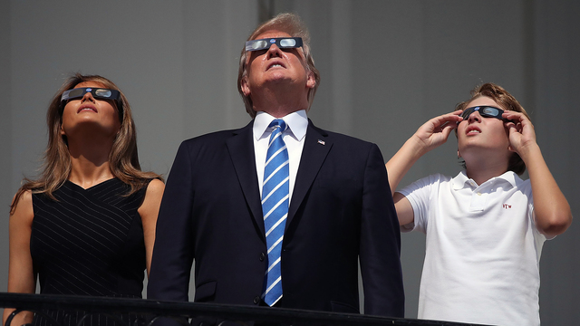 Watching solar eclipse Trump family.jpg43852314