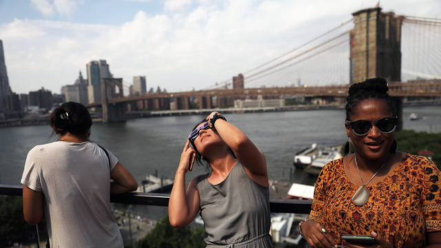 Watching solar eclipse in New York City.jpg69729300