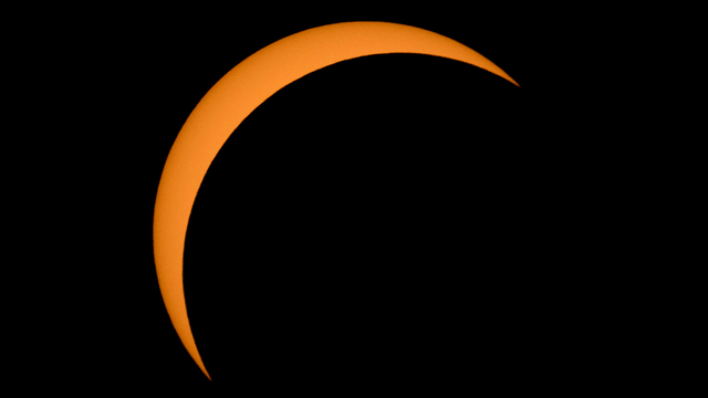 Watching solar eclipse partial coverage.jpg59841113