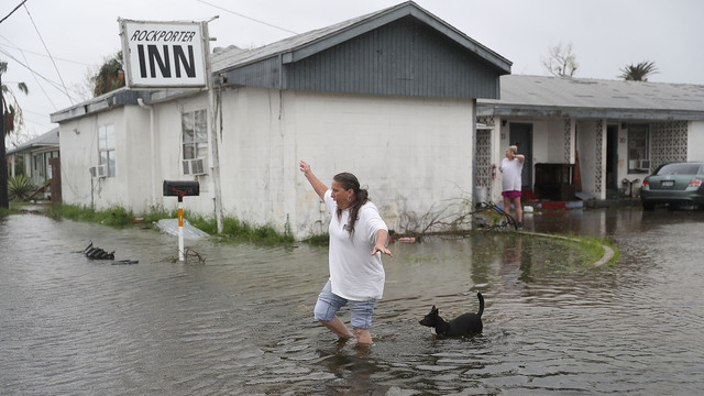 woman walks through flooded area, Rockport, Hurricane Harvey50813450