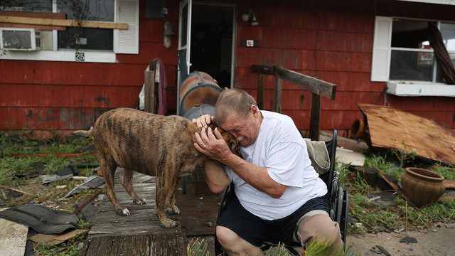 Dog, man crying in Rockport, Hurricane Harvey31096473