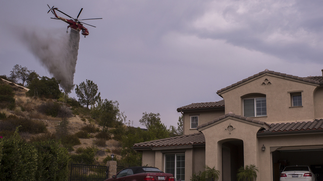 Helicopter drops to protect house, La Tuna fire, Burbank43073891