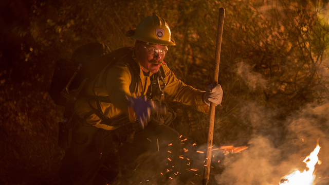 Firefighter fights flames with hand tool, burbank, la tuna fire, california75686420