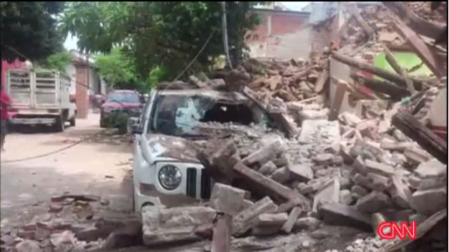 Policeman's body found in Mexico, quake toll 65