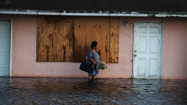 Hurricane Irma, woman in front of flooded Fort Myers home38785366