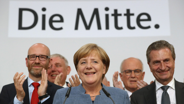 Merkel gets a fourth term but German voters deliver far-right surge