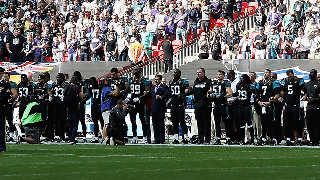 NFL players continue to act during playing of anthem