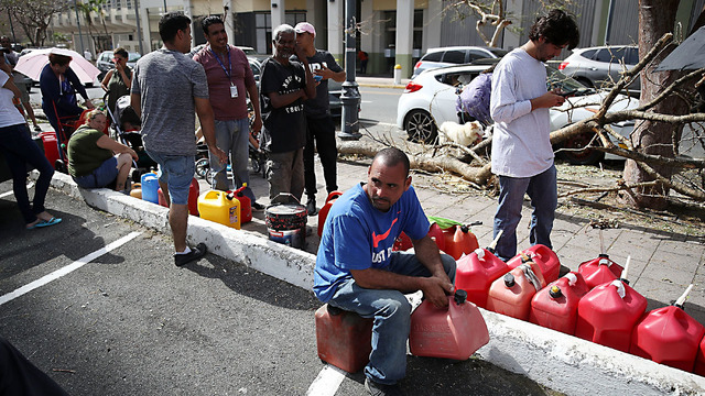 Puerto Ricans still wait for aid one week after Maria
