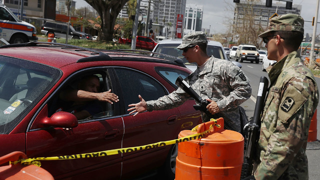 Lines for gas guarded by soldiers83382472