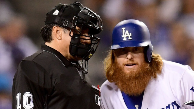 Justin Turner listens to Phil Cuzzi during Game 1 of 2017 World Series64309571