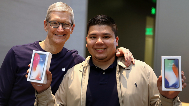 iPhone X release Tim Cook with customer.jpg46669390