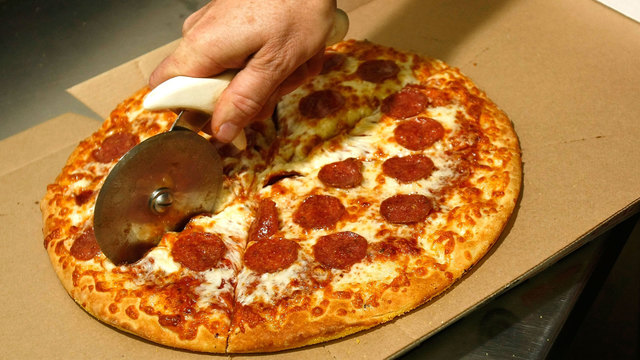 Little Caesars pizza being cut94803062