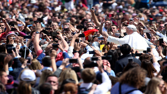 Pope Francis wants the faithful to lift hearts, not cell phones, during Mass