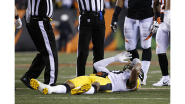 Steelers' Shazier huts back, carted off