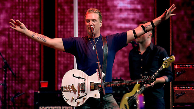 Queens of the Stone Age frontman 'truly sorry' for kicking photographer